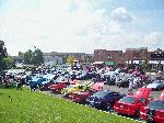 This is the crowd we had been waiting for / looking for all summer long.   We had 110 cars register and easily 60 - 70 which didn't want to register or more.  One person told me they had counted over 200 cars.  With having a dry morning the day of the show we had filled the normal parking lot in front of the Tilted kilt by 9:20 am.  By 10:00 am the lot around the corner and down further away from the resturant was filling up.  It was a fantastic show which kept me busy the whole time!  I tried to take pictures showing the whole thing as opposed to closeups of the ladies at the show.  Check out Norm's or Chad's galleries as they have nearly 1000 pictures from that day. - S_100_3184.JPG