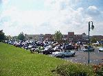 This is the crowd we had been waiting for / looking for all summer long.   We had 110 cars register and easily 60 - 70 which didn't want to register or more.  One person told me they had counted over 200 cars.  With having a dry morning the day of the show we had filled the normal parking lot in front of the Tilted kilt by 9:20 am.  By 10:00 am the lot around the corner and down further away from the resturant was filling up.  It was a fantastic show which kept me busy the whole time!  I tried to take pictures showing the whole thing as opposed to closeups of the ladies at the show.  Check out Norm's or Chad's galleries as they have nearly 1000 pictures from that day. - S_100_3185.JPG
